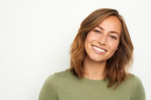 attractive woman happy with cosmetic dentistry