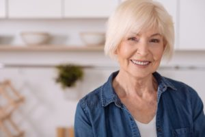 older woman happy with dental implants in Springfield